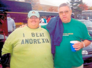 fat man in t-shirt that says I beat anorexia