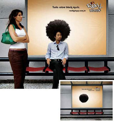 sign infront of seats with afro