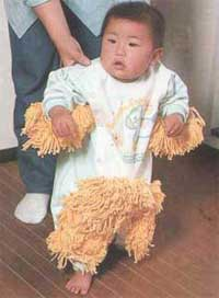 standing baby with mop on babygro